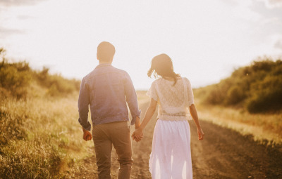 couple-walking-holding-hands